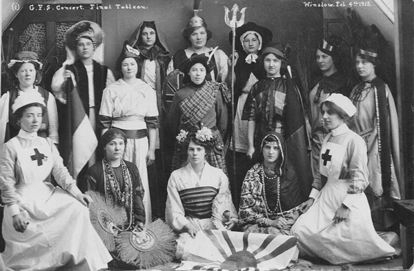 GFS Concert final tableau with girls in national costumes
