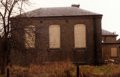 Magistrates' court with windows boarded up