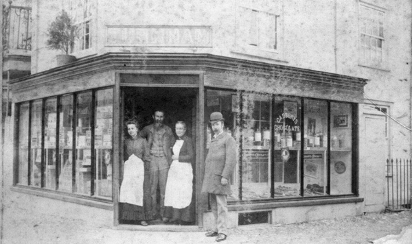 The Turnhams in their shop doorway
