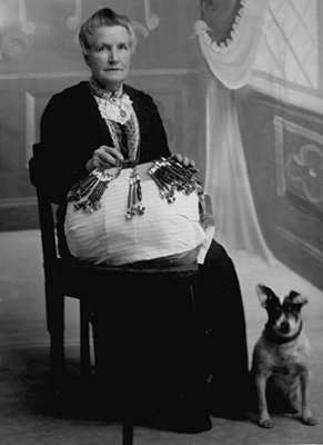 Mary Ann Walker with lace pillow and dog