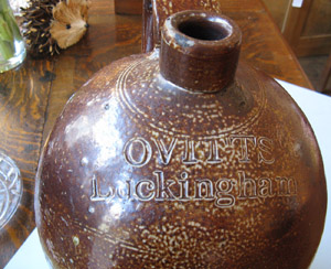 A flagon stamped Ovitts, Buckingham