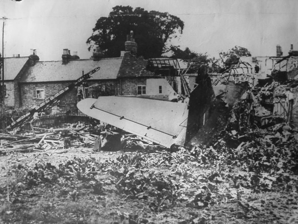 The wrecked plane and remains of the houses