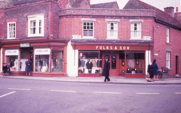 Colour photo of Fulks's with a policeman walking past
